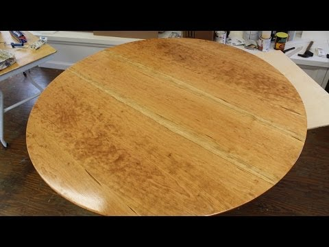 Make a round table top out of solid cherry wood.