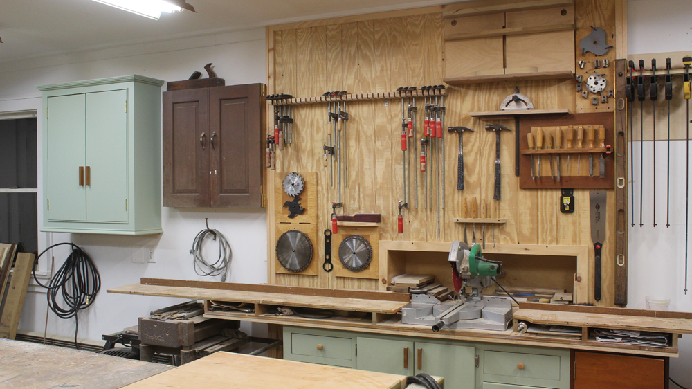 Make a few shelves, hang a cabinet and Organize the shop