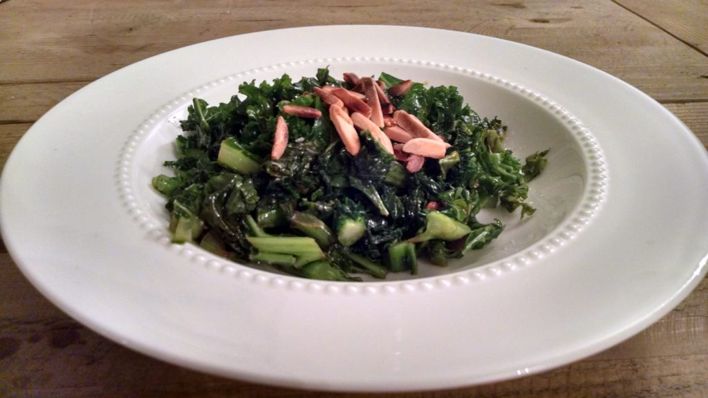 Kale, olive oil, a little balsamic and salt and pepper topped with crunchy toasted almonds