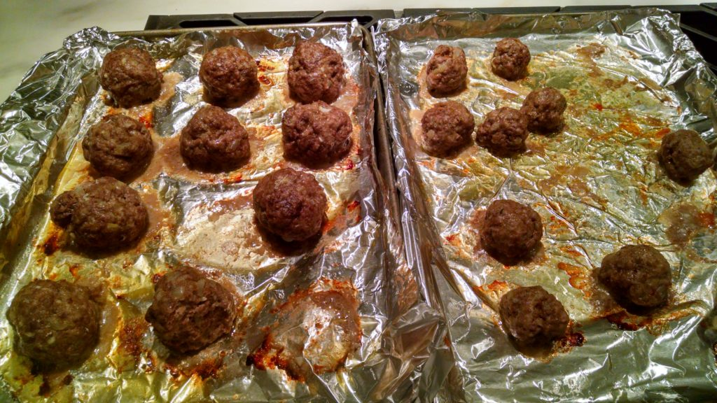 We couldn't help but sample a few meatballs fresh from the oven. We added some to the red sauce and froze some for another time. They freeze great and remain light, most and delicious if reheated slowly.