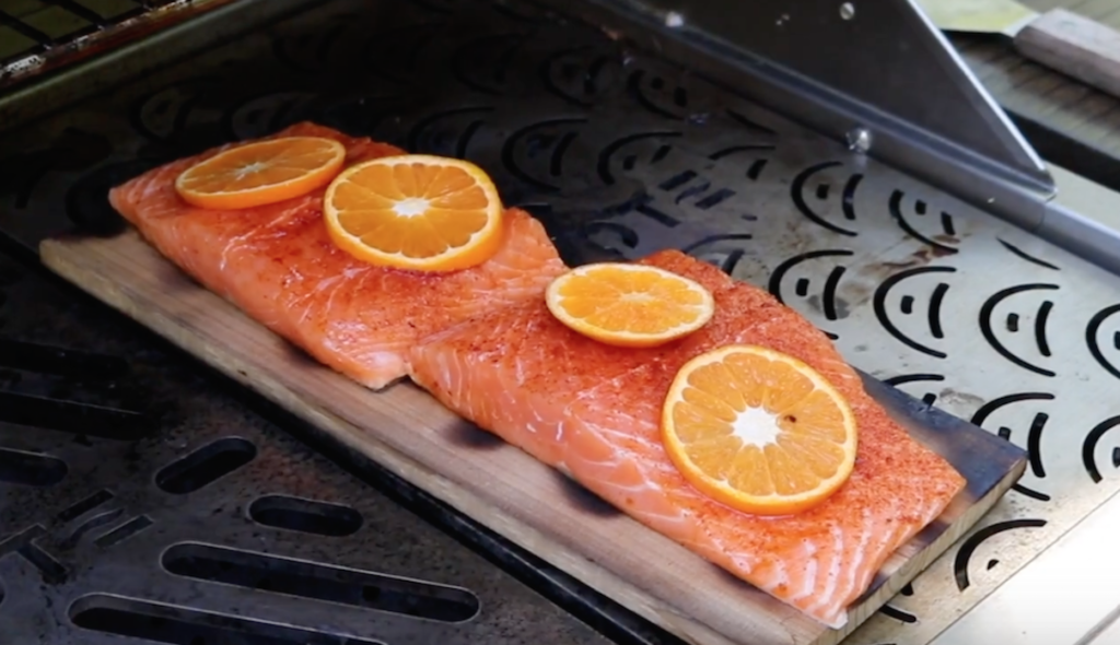 Place the pre-charred cedar planks topped with salmon on the cool portion of the grill for indirect cooking