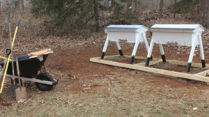Here are the new hives on on a platform made by 2 X 4's with a gravel base.  Wild flowers will be planted in the background for Spring.
